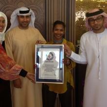 2014 Award ceremony of the Guinness world record for %22Largest Abaya%22 Ivory Grand Hotel Al Barsha. From Left Ayesha Siddequa N, Khalil Abdulwahid, shefali and ...