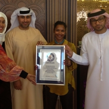 2014 Award ceremony of the Guinness world record for %22Largest Abaya%22 Ivory Grand Hotel Al Barsha. From Left Ayesha Siddequa N, Khalil Abdulwahid, shefali and ...